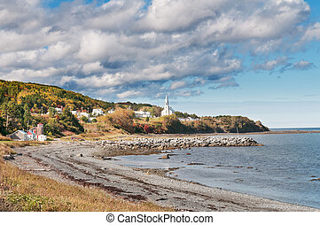 View into town with white church - View into a town with a...