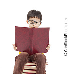 little boy studying on the books