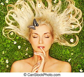 Young woman relaxing on a meadow