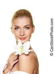 Beautiful blond woman with white lily flower