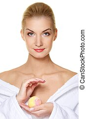 Beautiful young woman with aroma bath ball