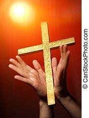Golden cross in human hands