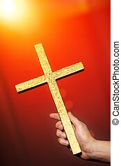 Golden cross in human hand