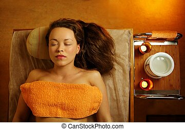 Beautiful woman relaxing in a massage salon