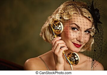 Lovely woman talking on the phone. Retro portrait