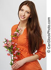 Beautiful brunette woman with a flowers