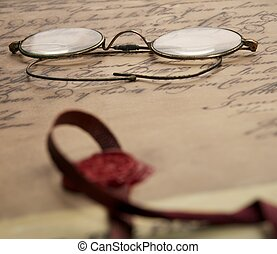 Old glasses on the vintage document