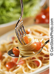 spaghetti - fresh spaghetti on fork and spoon close up shoot