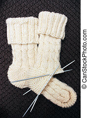 Knitted socks - Socks knitted from white woolen yarn on a...