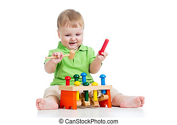 baby boy playing toy isolated on white background
