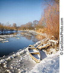 winter river - Boat on the bank of the winter river