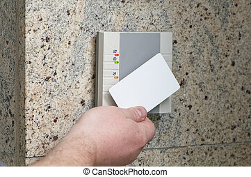 hand with the card access - man puts the card into the...