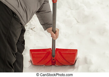 Hand with a snow shovel