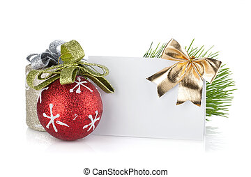 Empty christmas gift card and balls. Isolated on white...