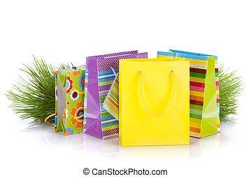 Colorful gift bags with christmas gifts. Isolated on white...