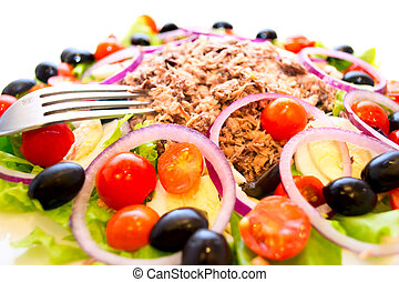 Delicious salad with tuna, tomatoes, eggs, olives and peppers.