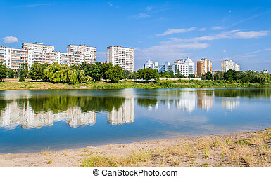 Residential buildings over a lake. Kyiv, Ukraine