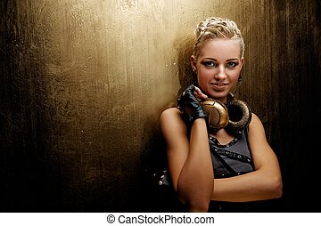 Attractive steam punk girl with headphones smiling