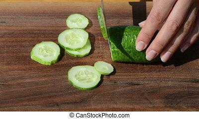 hands cut cucumber knife - Female hand cut chop slice green...