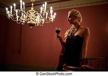 Beautiful lady with a glass of wine.