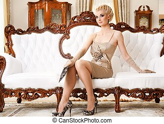 Beautiful blond woman in luxury interior