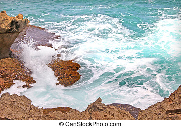 sea foam,rocks and turquoise sea water