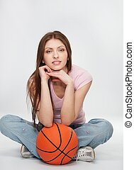 Beautiful brunette woman with a orange ball