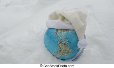 earth globe snow cap hand - Earth globe sphere in winter...