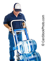 Water Delivery - Water delivery man with hand truck, viewed...