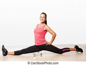 Beautiful athlete woman doing splits
