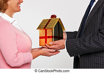 A woman receiving a new home