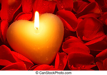 Heart shape candle and rose petals - A heart shape candle...