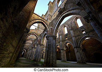 Abbey of San Galagano at sunset - Wide angle view of the...
