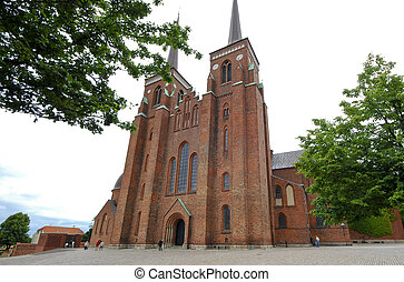 Exterior of the cathedral of Roskilde in Denmark - Wide...
