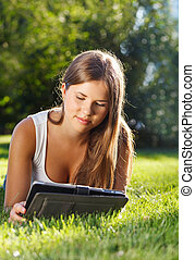 Happy young girl using a tablet computer