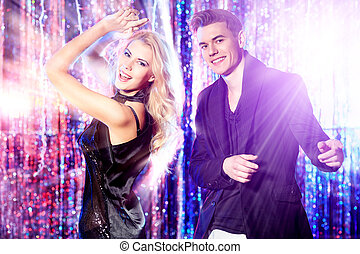 dancing couple - Couple of cheerful young people dancing at...