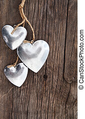 Hearts on wooden background - Metal hearts on wooden...