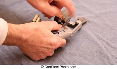 loading a revolver - hand loading a stainless steel revolver