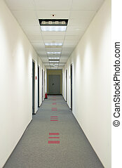 corridor with gray carpet and white wall