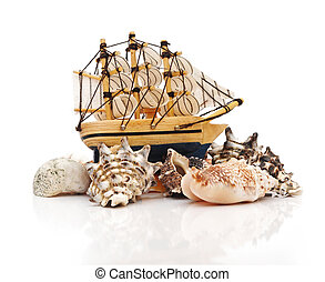 model classic boat on sea shells