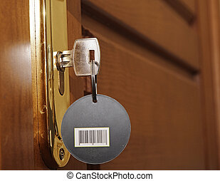 key in keyhole and black label with barcode