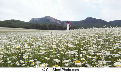Among the daisies - Woman in a field among the blossoming...