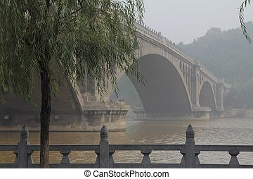Bridge on the Yi River, China - Bridge and fog on the Yi...