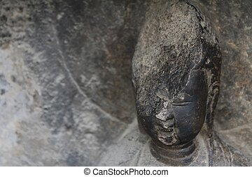 Detail of carved stone Buddha at Longmen Grottoes, a UNESCO...