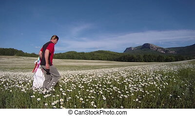 In the chamomile meadow - Father and daughter spending time...