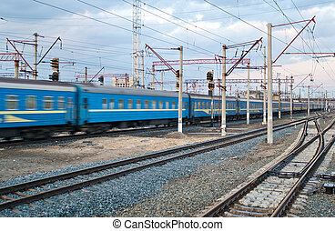 Passanger train passing the station Darnytsia, Kyiv, Ukraine