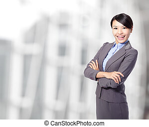 business woman cross arms at office - Smiling business woman...
