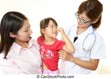 Smiling doctor and happy patients