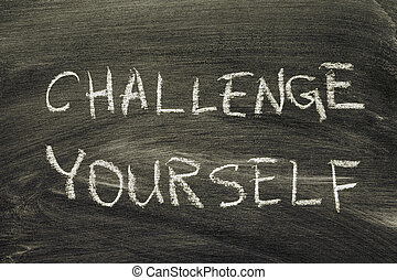 challenge yourself phrase handwritten on school blackboard