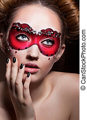 Painted Face. Beautiful Girl in Red Carnival Mask. Masquerade
